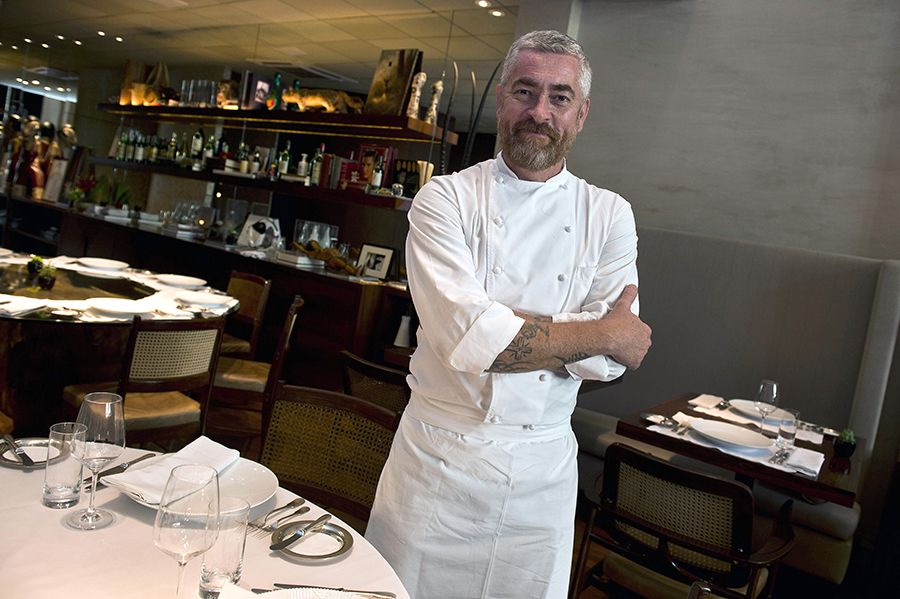 TO GO WITH AFP STORY BY NATALIA RAMOS Brazilian chef Alex Atala speaks posesg an interview with AFP at his DOM restaurant in Sao Paulo, Brazil on November 13, 2013. The DOM restaurant was chosen as the second best in Latin America by international industry experts, including representatives of the region's most influential restaurants, famous chefs and members of the specialized international press. AFP PHOTO / NELSON ALMEIDA